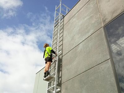 AM BOSS access ladders fall protection system Ladline building exterior