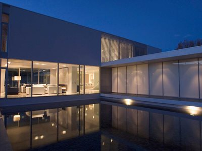 Outdoor pool image of residential house with insulated glass