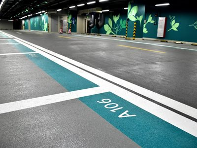 Detail of underground car park with numbered sections and floral wall design