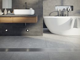 Stormtech lineal grates that blend with modern bathroom designs