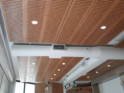 timber ceiling panels integrated lights office interior