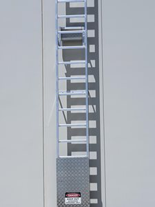 AM BOSS access ladders fall protection system Ladline on building facade