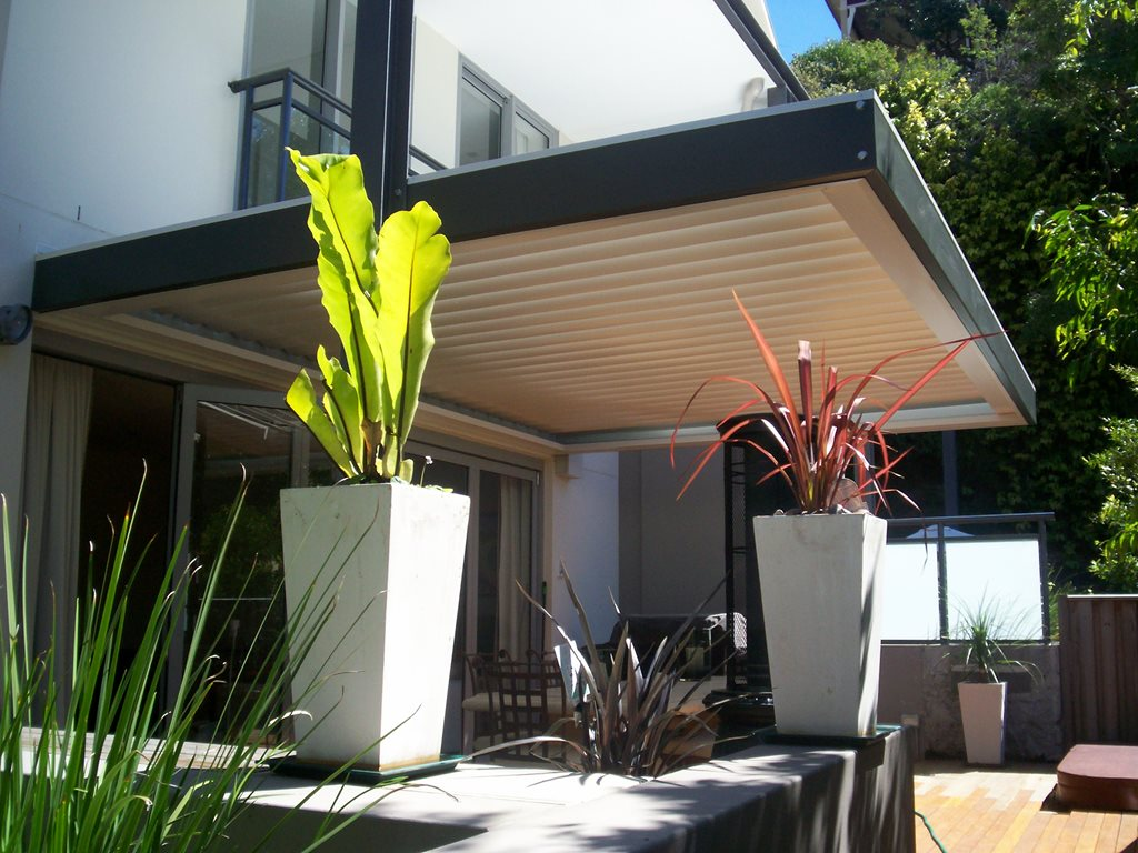 Louvred opening and closing pergolas for shade and shelter