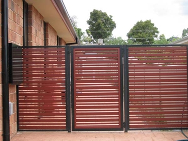 Superior-Steel-Aluminium-and-COLORBOND-Steel-Fencing-and-Gates Red Driveway