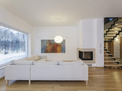 White modern living room interior with insulated glass windows