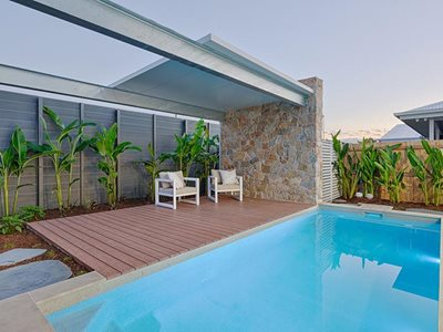 Outdoor pool area with non combustible timber decking