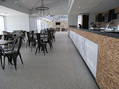 Cafe interior featuring resin flooring