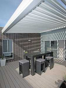 Outdoor deck with louvre sun shade system