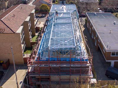 Steel roof truss at Pine Ave Townhouse project