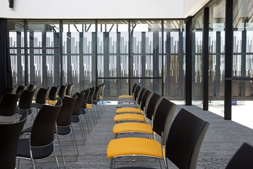 The building has several meeting and conference rooms of varying sizes. Photography by James Knowler