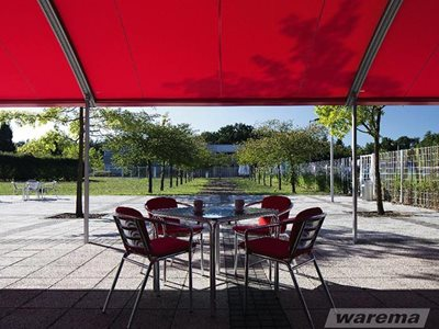 Red pergola awnings in outdoor hospitality setting