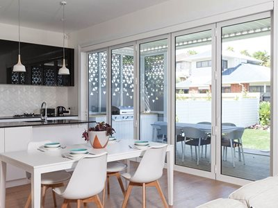 Modern living room interior with insulated glass patio doors