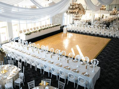 wedding setting tables around dance floor