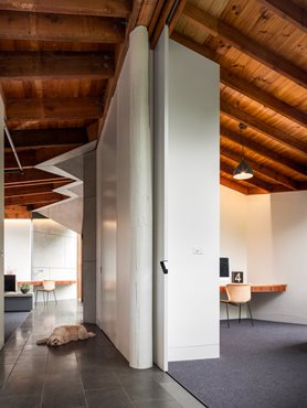 Chamfer features on ceiling. Cavity slider creates a flexible living space. Photography by Andrew Latreille