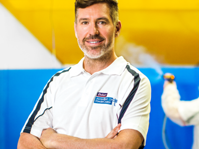 Portrait of Dulux Accredited Powder Coater With Arms Folded