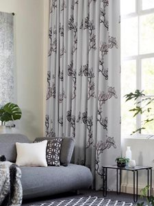 Residential interior with Norfolk patterned curtains