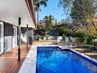 Outdoor pool patio with non-combustible timber decking