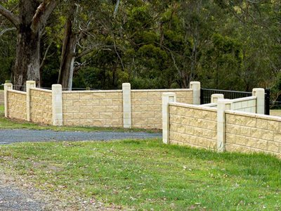 Park with boundary concrete masonry fence system
