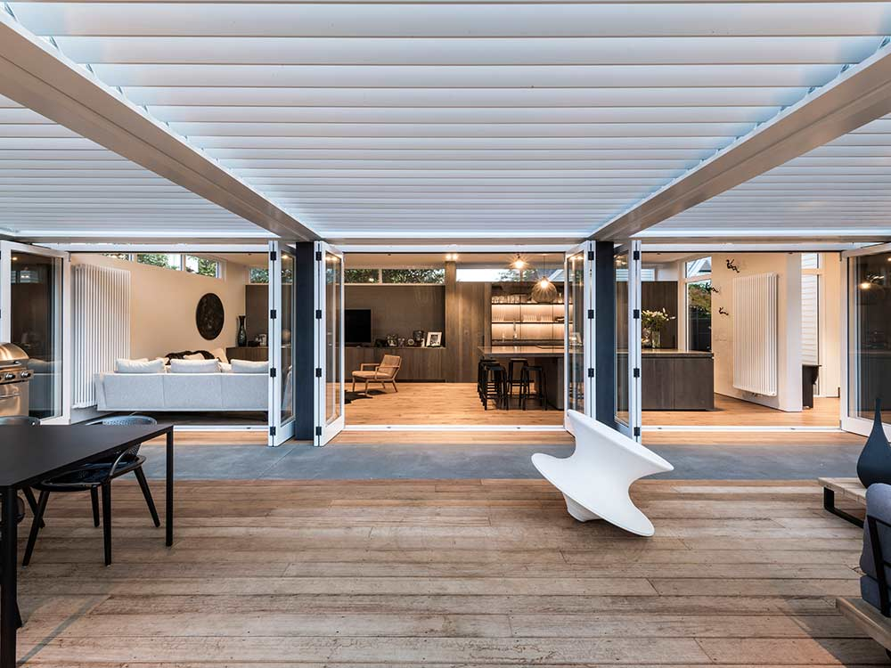 LourvreTec White Opening Roof Louvres on Modern Patio with Open Doors
