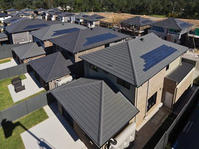 Aerial view of houses with solar roof tiles