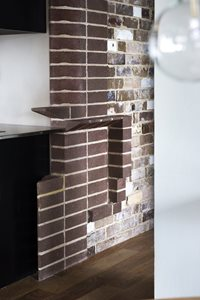 Recycled bricks were used to create the interior feature walls in the apartments. Photography by Brigid Arnott.