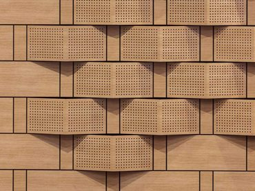 The custom perforated saw-tooth panels offer an absorptive and diffuse surface
