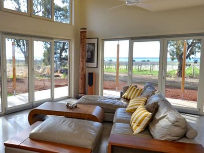 Living room interior with insulated glass windows and doors