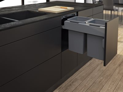 Dark grey kitchen interior with under counter bins