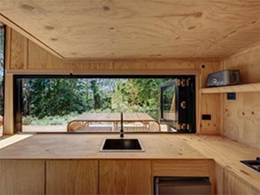 Cabin interior with timber ecoply panels