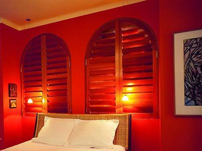 Bedroom interior with plantation shutters