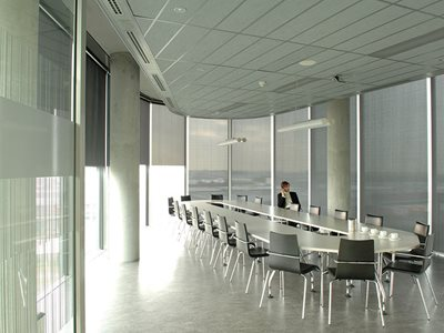 Verosol SilverScreen solar radiation roller blind in commercial office meeting room interior