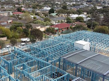 the building features prefabricated SBS Smart Frame for the top level wall and roof truss framing