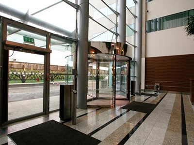 Building interior showing revolving doors entrance doors