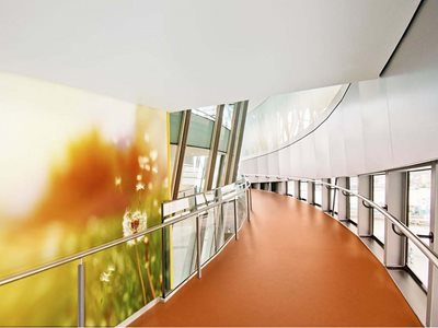 Highly durable and customisable wall and flooring products in hospital corridor