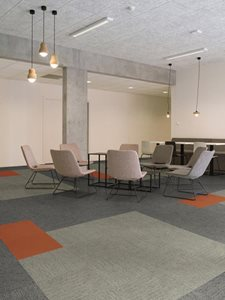 Commercial meeting room interior with textile composite floor