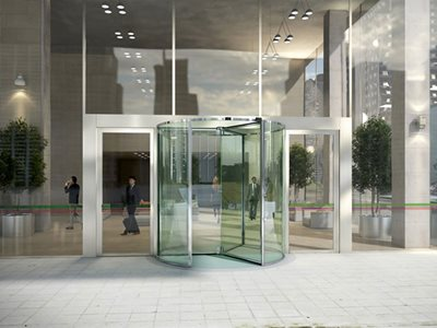 Entrance of office building with glass revolving doors