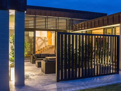 Night Time Exterior View of LouvreTec Airfoils Louvres in Backyard