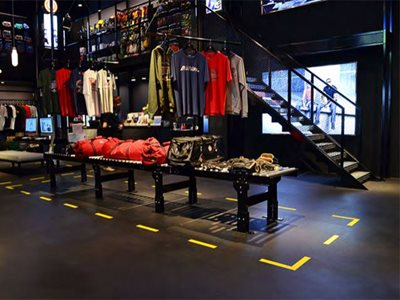 retail shop black floor yellow accent colour