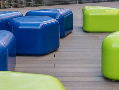 Outdoor furniture sitting on decking outside Imperial College