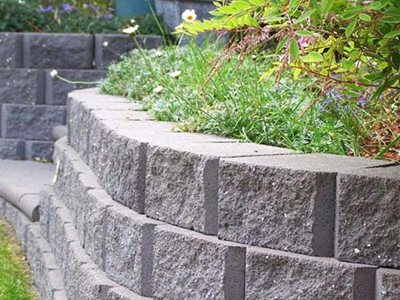 Grey retaining wall with garden beds