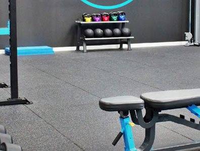 rubber gym flooring blue accents bench