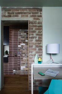 The feature walls in the apartments were created with recycled bricks. Photography by Brigid Arnott.