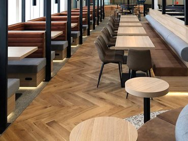 The timber flooring provides an earthy grounding and luxurious element to the dining area and tasting table