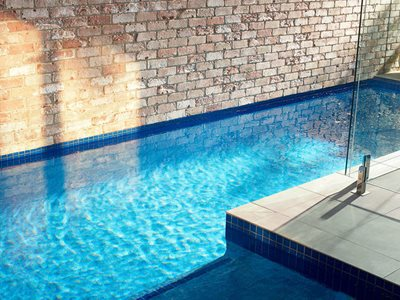 swimming pool reclaimed brick wall