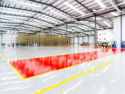 Resin commercial flooring in factory setting
