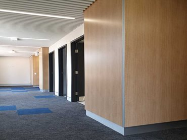 The walls adjacent to the lift doors are lined with durable SUPALINE panels finished in SUPAFINISH Tasmanian Oak laminate