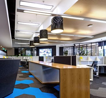 "Carpet tiles were used by Graphite Architects at Mingara Leisure Group Corporate Offices, Newcastle. ""[They] offered acoustic absorption [and] softness underfoot… [while still being] firm enough to feel like a commercial environment,"" says Principal Design Architect, Sandy Strazds. Image: Graphite Architects"