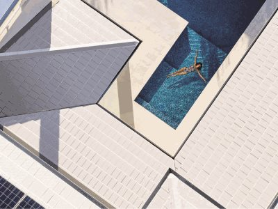 woman swimming pool white roof solar tiles