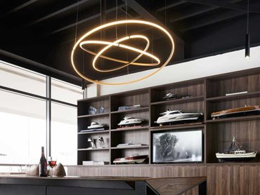 Olympic Three Ring bronze pendant was used as a feature light over the main seating area