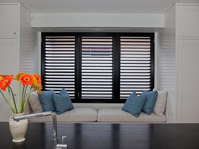 Living room interior with black window plantation shutters